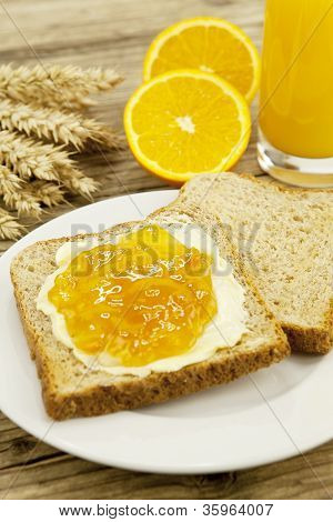 Tasty Breackfast With Toast And Marmelade On Table