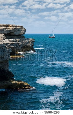 Rocks, The Sea And The Yacht...