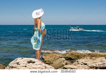 A Pregnant Woman And The Sea