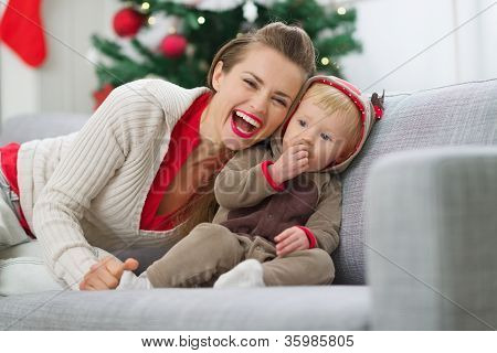 Smiling Young Mother And Baby Having Fun Time On Christmas