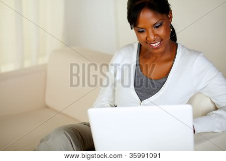 Charming Young Woman Working On Laptop