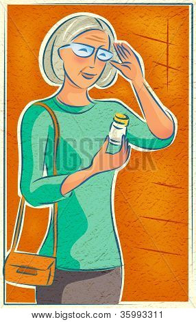 An elderly woman looking at her medication bottle