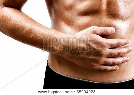 Handsome young man with stomach pain isolated on white background