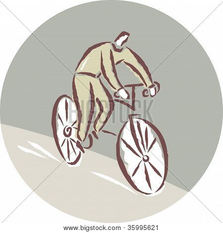 A Man Cycling On A Bicycle