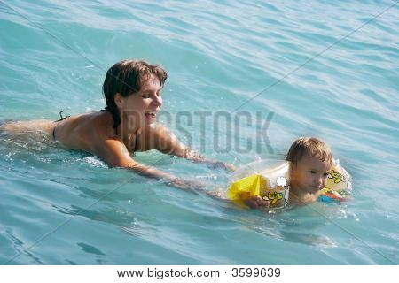 Mother And Baby Swimming