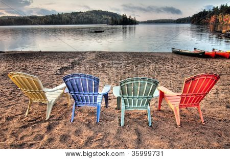 Four Patio Chairs Looking Over Lake