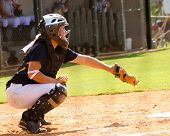image of softball  - Young teen girl playing softball in organized game - JPG