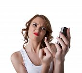 pic of fuck  - Anger Young woman show fuck finger on cell phone isolated - JPG