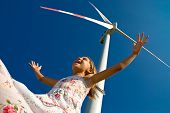 stock photo of dynamo  - child playing with the wind near a turbine - JPG