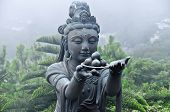 foto of buddha  - A state in the vicinity of the Great Buddha of Tian Tan Hong Kong. Tian Tan Buddha also known as the Big Buddha is a large bronze statue of a Buddha completed in 1993 and located at Ngong Ping Lantau Island in Hong Kong.