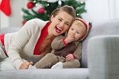 picture of deer family  - Smiling young mother and baby having fun time on Christmas - JPG