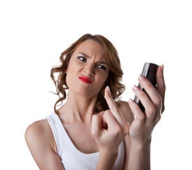 picture of fuck  - Anger Young woman show fuck finger on cell phone isolated - JPG