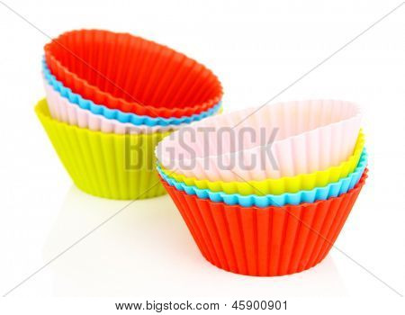 Stack of colorful cupcake cases isolated on white