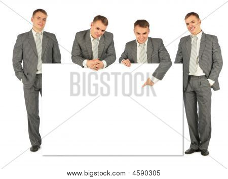 Business People Of Four With Board For Text