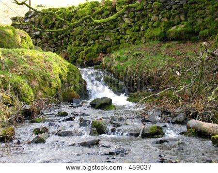Waterfall And Stone Wall