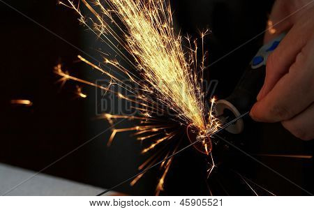 Sparks while sawing metal. close up