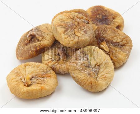 Dried figs in a pile on a white background.