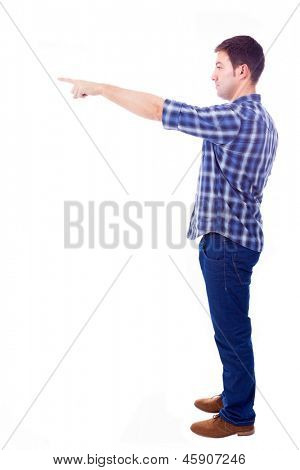 young casual man pointing towards copyspace, isolated on white background