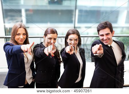 Businesspeople pointing at you and smiling