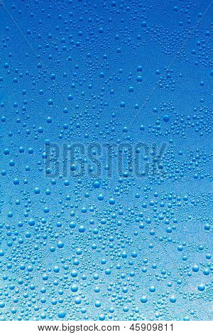 Water drops on a blue glass background