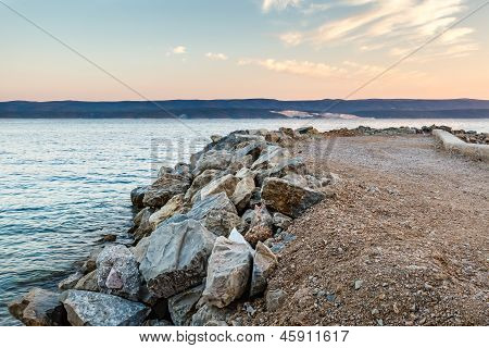 Breakwater On Makarska Riviera At Sunset, Croatia