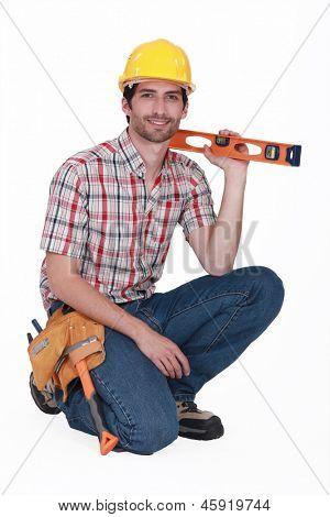 happy carpenter holding ruler