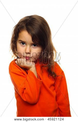 portrait of curly brunette girl child orange sweater flirt