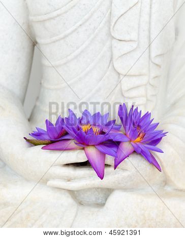 Fresh Flowers In Buddha Image Hands