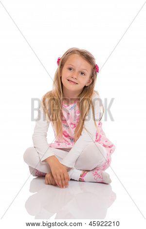 Portrait Of A Little Girl Sitting