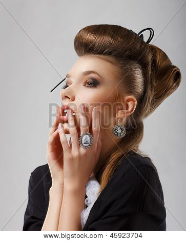 Inspiration. Gorgeous Caucasian Woman With Jewelry. Updo Hair
