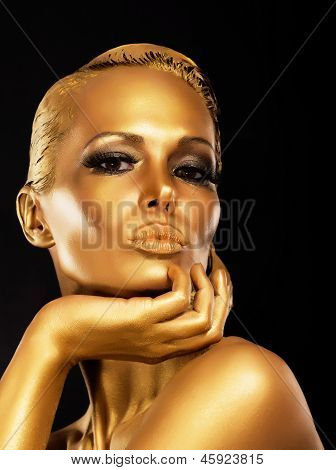 Fantasy. Face Of Styled Enigmatic Woman With Gold Make-up. Luxury