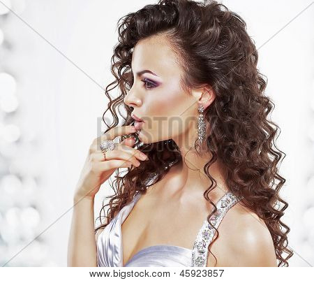 Classy Elegant Woman With Jewelry - Platinum Ring And Earrings. Frizzy Hairstyle