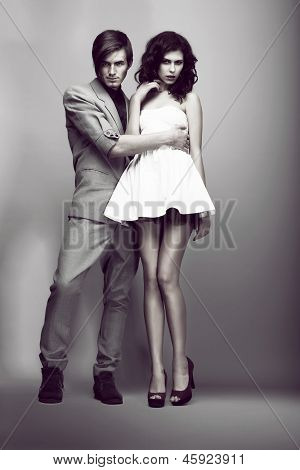 Temptation. Passion. Fashion Couple In Trendy Clothes Hugging. Elegance