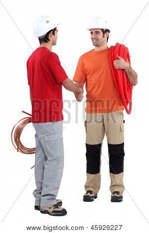 Plumbers shaking hands
