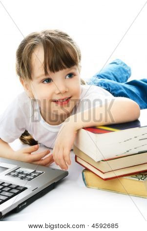 Girl On The Floor With Books And A Laptop