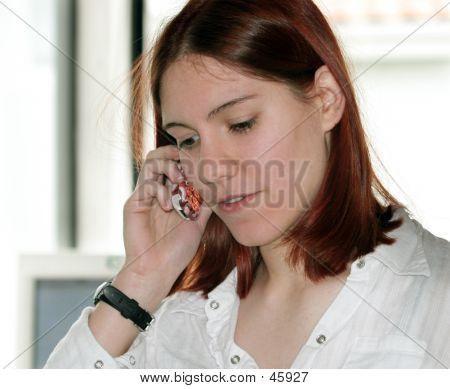 Redhead Girl On The Phone
