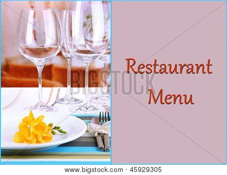 Table setting with glasses for different drinks on table on room background