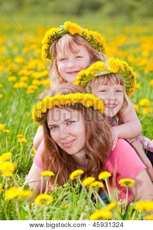 Young woman with two cute little girls enjoying a summer day outdoors