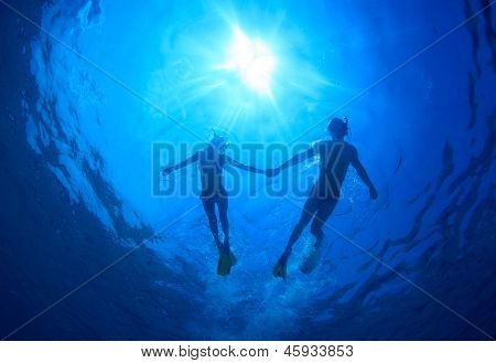 Young couple snorkeling together in a topical sea