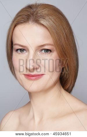 Portrait of beautiful smiling happy mature woman with clear skin