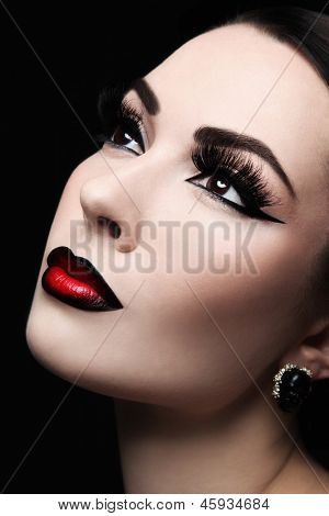 Close-up portrait of young beautiful woman with gothic ombre lips