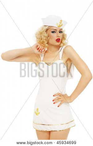 Young beautiful sexy slim girl with blond curly hair and stylish make-up dressed as sailor, over white background