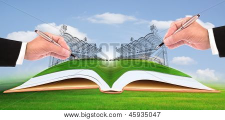 hand writing stadium on green grass use for construction and healthy theme