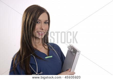 Beautiful Brunette Nurse Holds Patient Medical Chart Data In Clipboard