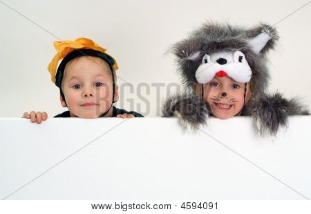 Funny Kids Above Big Blank Sheet Of Paper