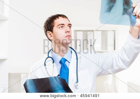 Doctor looking the x-ray