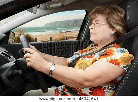 Senior Woman Driving A Car