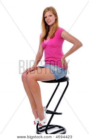 Young Woman Sitting On Stool