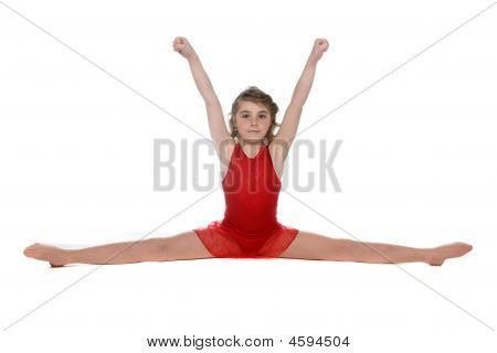 Young Girl Doing A Split With Arms Raised Above Her Head