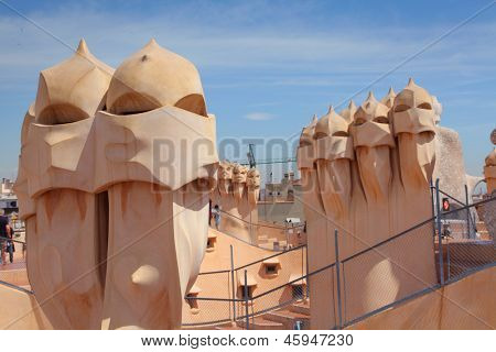 BARCELONA, SPAIN - MAY 7: Casa Mila or La Pedrera on May 7, 2013 in Barcelona, Spain. This famous building was designed by Antoni Gaudi and is one of the most visited of the city.